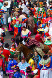 Inti Raymi Festival. Pujili, Ecuador - 07 July 2011: Group Of Men Dressed In Traditional Colorful Costumes On The Streets Of Pujili Inti Raymi Festival In Pujili Stock Photo