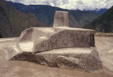 Intihuatana stone at Machu Picchu, Peru. Royalty Free Stock Images