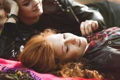 Intimacy between girls. Intimacy between two lesbian girls while lying on the blanket stock image