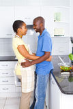 Intimate african couple in kitchen Stock Image