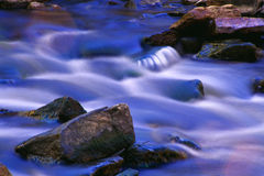 Intimate Cascade. An intimate cascade and flowing water on a creek in Pennsylvania stock image