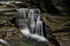 Intimate Cascading Falls. Located in Ithaca NY, this stunning trail takes you through Robert Treman State Park. There are several styles of waterfalls which are stock photos