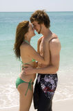 Intimate couple on the beach royalty free stock photography
