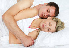 Intimate couple in bed Royalty Free Stock Photos