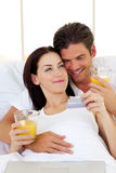 Intimate couple drinking orange juice Royalty Free Stock Photo