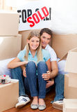 Intimate couple embracing after move in Stock Photos