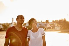 Loving couple looking at the sky Stock Images
