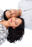 Intimate couple lying on the floor Royalty Free Stock Photos