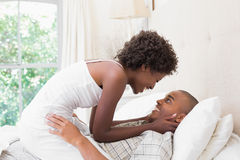 Intimate couple messing about in the morning on bed Stock Photography