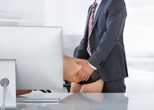 Intimate couple in office Stock Photo