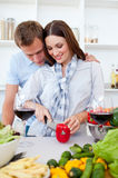 Intimate couple preparing dinner. In the kitchen Stock Photos