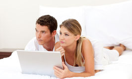 Intimate couple using a laptop Stock Photo