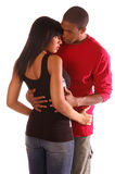 Intimate  Embrace. African American couple standing in intimate and tender embrace Stock Image