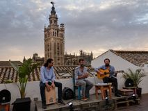 Intimate flamenco show in front of Seville Cathedral,The Giralda, the bell tower of the Seville Cathedral i stock photo