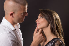 Intimate flirting boy girl couple young smiling black background Royalty Free Stock Image