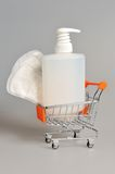 Intimate gel dispenser pump plastic bottle, sanitary towel in pushcart Stock Photography