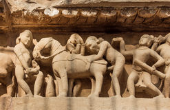 Intimate life of ancient people on stone relief on wall of Khajuraho temple, India. UNESCO Heritage site Stock Images