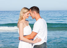 Intimate lovers embracing at the beach Stock Images