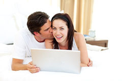 Intimate lovers using laptop Stock Images