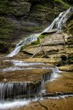 Intimate Lucifer Falls. Located in Ithaca NY, this stunning trail takes you through Robert Treman State Park. There are several styles of waterfalls which are royalty free stock image