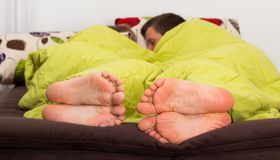 Intimate Moment. Cute couple lying in bed asleep, intimate moment Royalty Free Stock Photo
