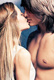 Intimate moments. Young beautiful couple kissing studio shot