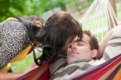 Intimate moments - young couple outdoors. Young couple in love having intimate time outdoors - detail of girl bending over boy Stock Photo