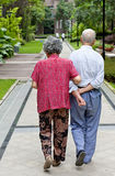 An intimate senior couple. Are walking Stock Image