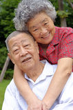 An intimate senior couple embraced Stock Image