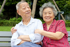 An intimate senior couple embraced. An intimate senior couple is happy Stock Photography