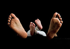 Intimate Time : Baby and Mom. Legs of baby and his mom show the intimate of them Royalty Free Stock Image