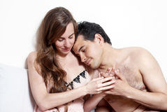 Intimate young couple during foreplay Stock Photos