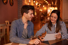 Intimately smiling millenial couple in restaurant Royalty Free Stock Photography