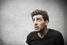 Intimidated. Young man intimidated by someone Stock Images