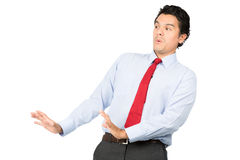 Intimidated Latino Worker Defensive Position. An intimidated latino man in business clothes, dress shirt, tie in defensive position leaning back, appeasing stock image
