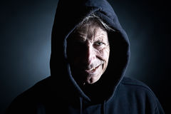 Intimidating Distinguished Man in Hooded Top Stock Image