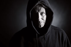 Intimidating Senior Male in Hooded Top Royalty Free Stock Photos