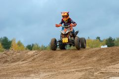 In an intimidating way. SERPUKHOV, RUSSIA - OCTOBER 7, 2017: Zolin Nikita 11,  Class ATV-JUNIORS, in the 4 stage  MX series, the Red Wings Cup 2017 super country Royalty Free Stock Photography