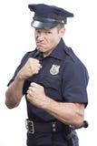 Intimideer cop op witte achtergrond stock fotografie