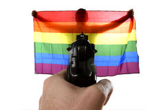 Intolerance violent representation of terrorist attack with hand pointing gun on proud gay holding flag Stock Images