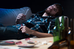 Intoxicated guy with a joint. Intoxicated drug addicted guy with a joint Royalty Free Stock Image