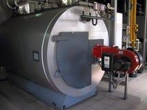 Intoxique caldeiras de vapor boiIndustrial na sala de caldeira, e burnerslers poderosos do gás da turbina na sala de caldeira do  fotografia de stock royalty free