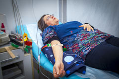 Intravenous infusion therapy on mature woman Stock Photos