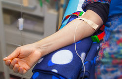 Intravenous infusion therapy on mature woman Stock Image