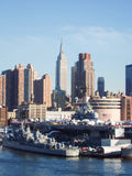 Intrepid museum and Empire State Building Stock Photography