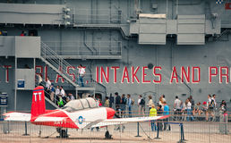 The Intrepid Sea-Air-Space Museum. People are waiting in line  to go into The Intrepid Sea-Air-Space Museum during Fleet Week. The Intrepid Sea-Air-Space Museum Stock Image
