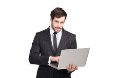 Intresting businessman with a laptop Stock Images