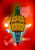 Intricate arabic lamp with blurred lights Stock Photo