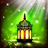 Intricate Arabic lamp with lights. On shiny green background. EPS 10 Royalty Free Stock Images