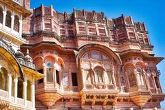 Intricate architecture in ancient Jaipur. Rajasthan India. Pink and gold adorn the filigree work on the facade of this home in India stock image